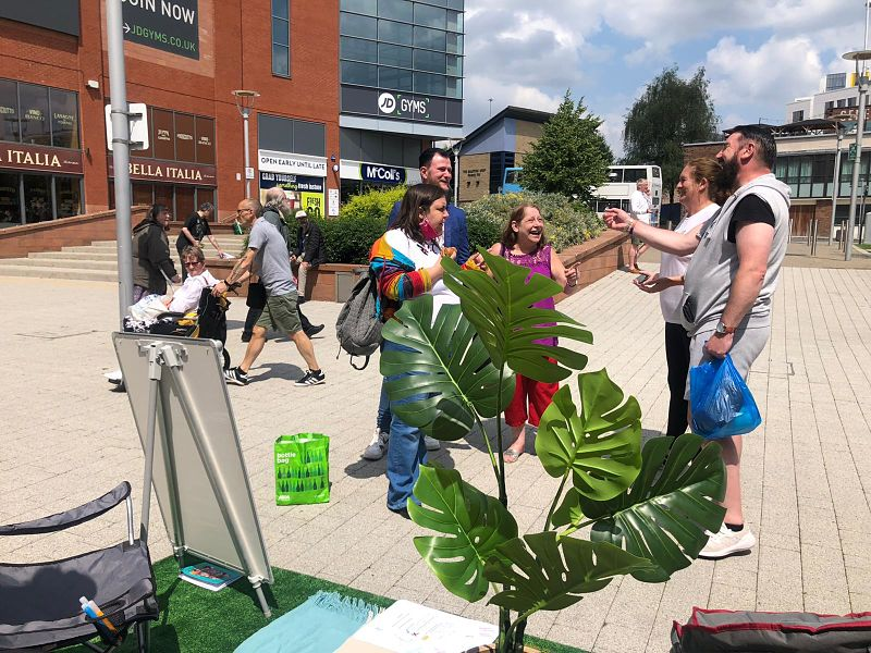 A crowd gathers for the parklet by Grapevine in Coventry city centre
