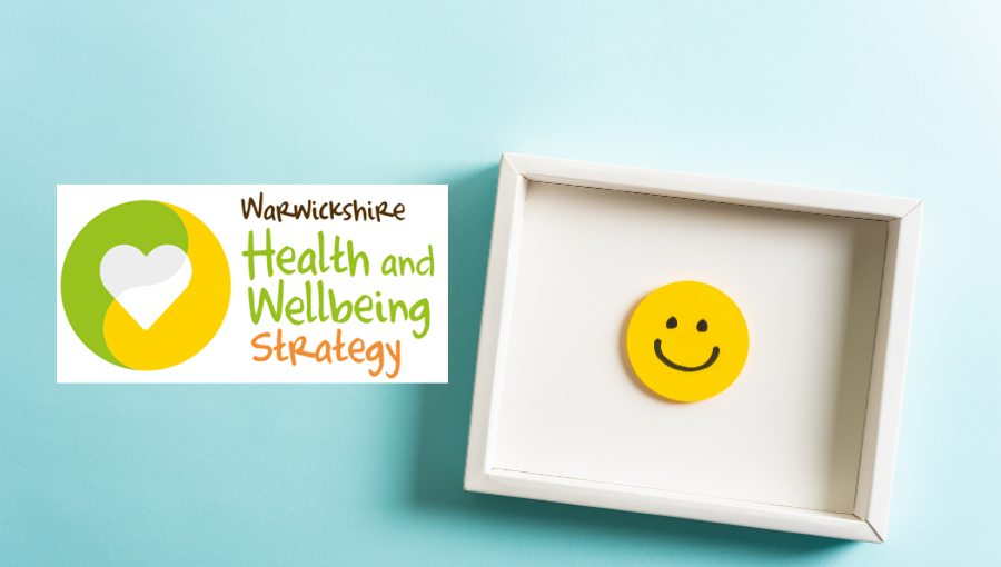 The Warwickshire Health and Wellbeing Strategy logo sits on a blue background with a white picutre frame showing a yellow smiley face