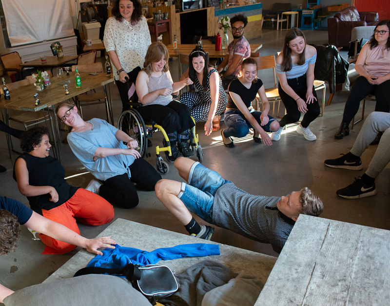 A group of young people of all abilities parties together in a local coffee shop.