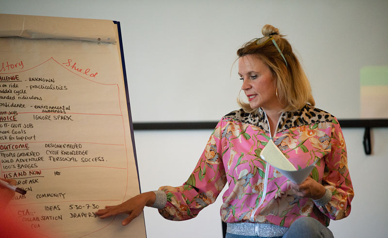 Mel from Grapevine points to notes on a flipchart