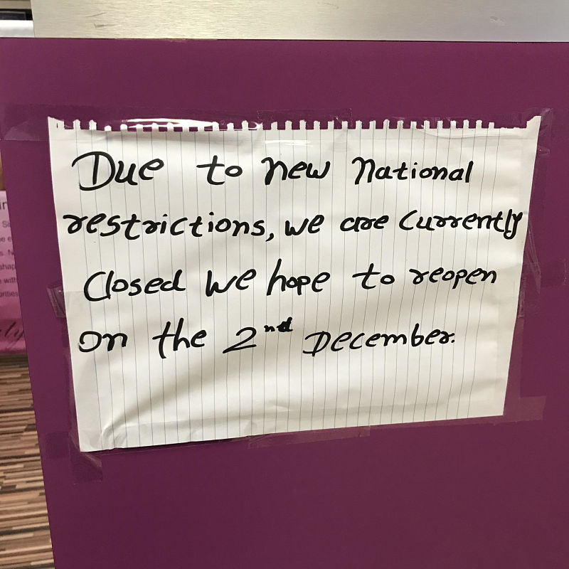 Handwritten shop closure note during Covid pandemic