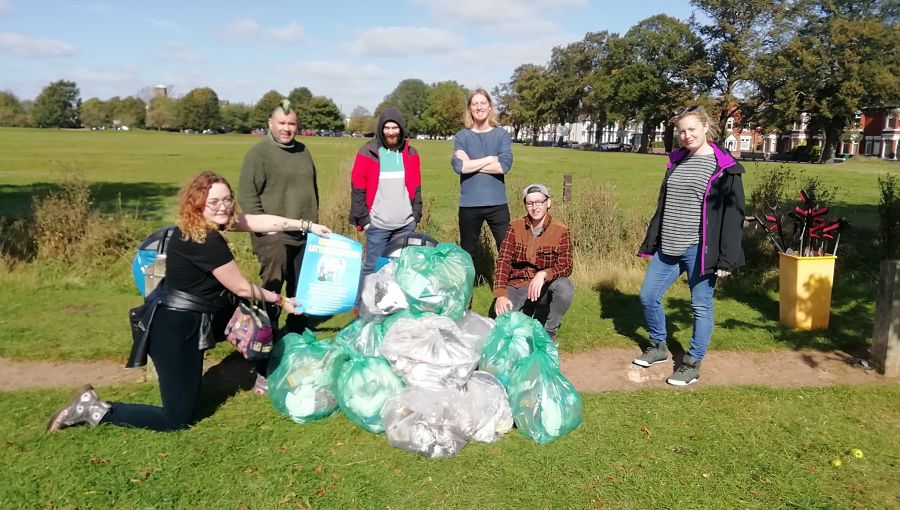 A group of litter pickers with the rubbish they have collected in their community