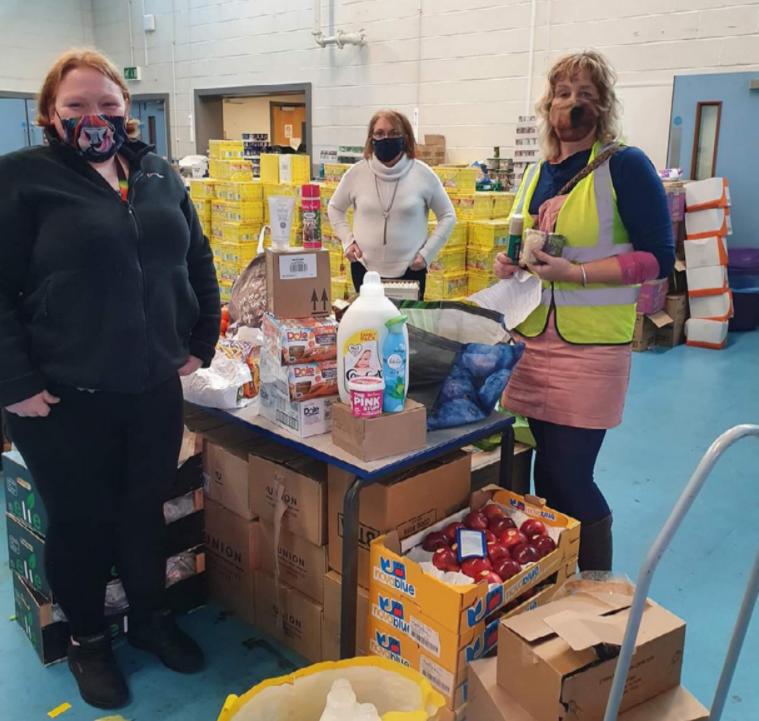 People distribute food parcels during lockdown