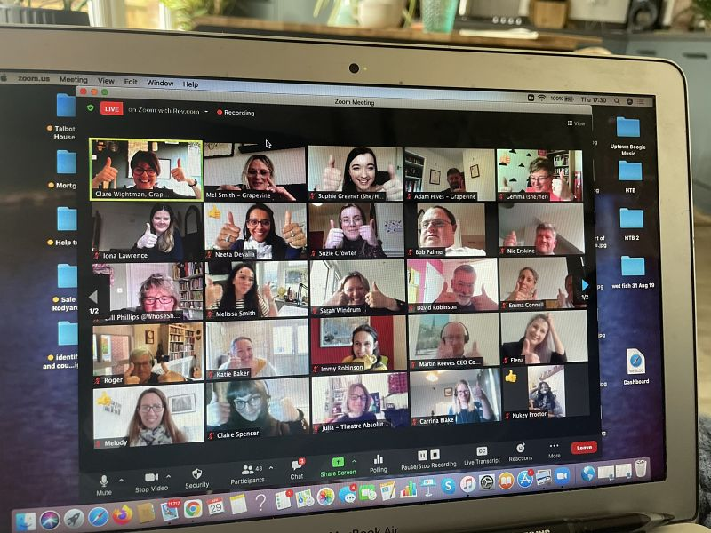 Screen shot showing participants of an online summit by Grapevine in April 2021 smiling, waving and holding their thumbs up