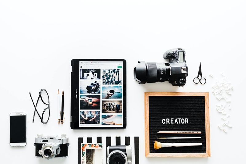 The tools of creativity laid out on a desk