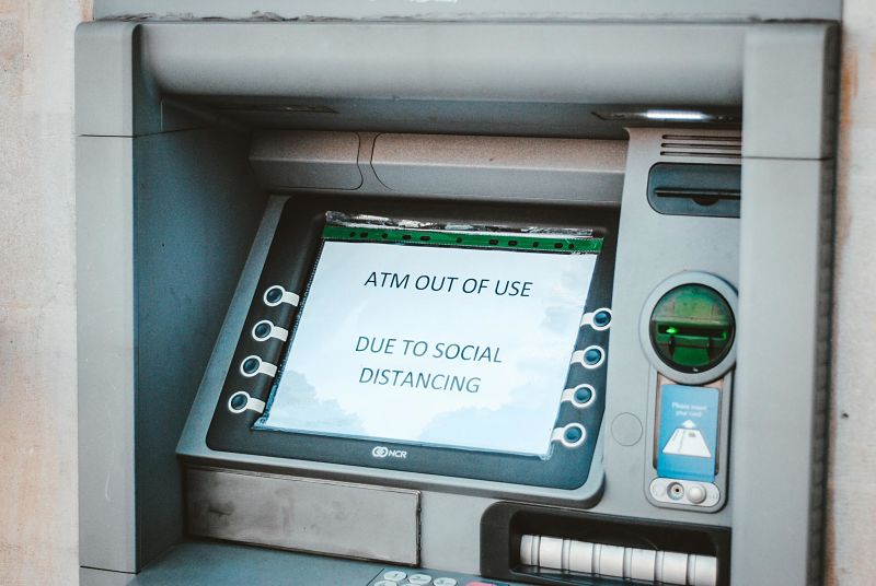 An ATM screen says out of service due to social distancing