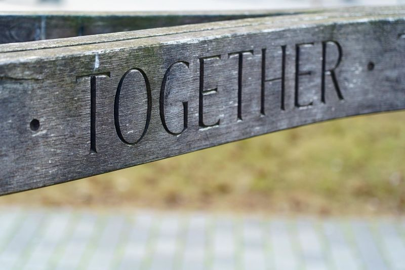 """A wooden bench reads """"Together"""""""
